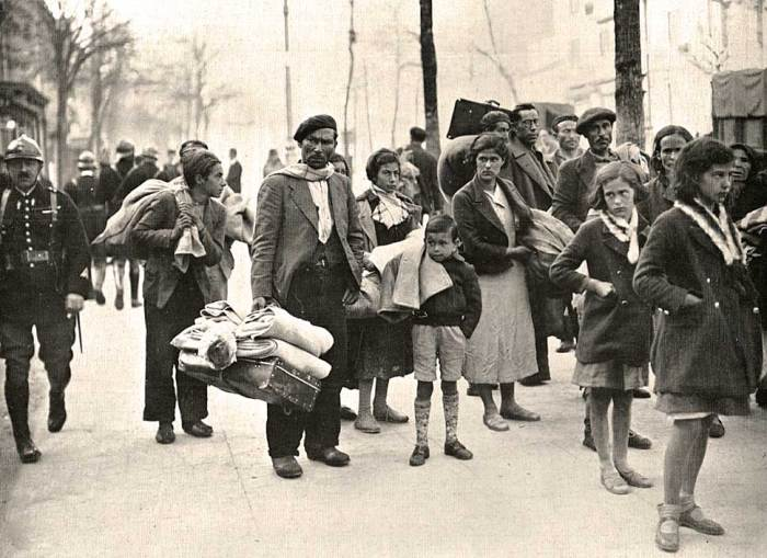 Spanish refugees in Paris. And with war comes armies of shattered and displaced.