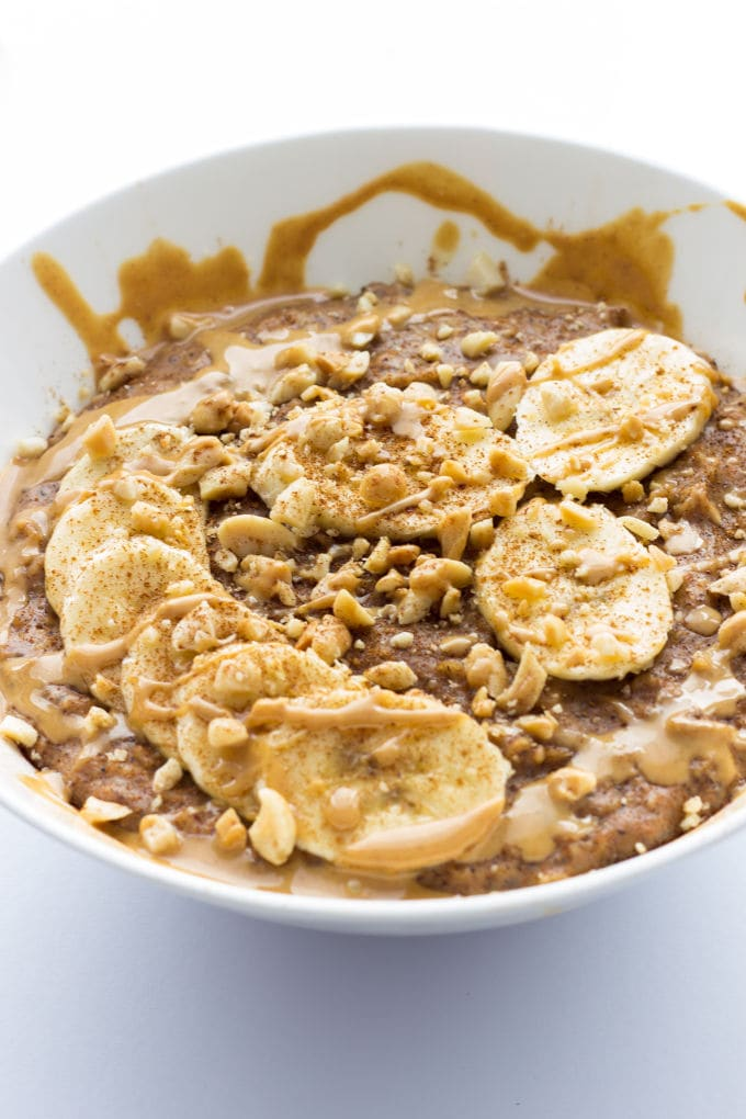 This Peanut Butter Porridge is easy to make, SO comforting and extra healthy! Vegan, Gluten-Free, Dairy-free | onecleverchef.com