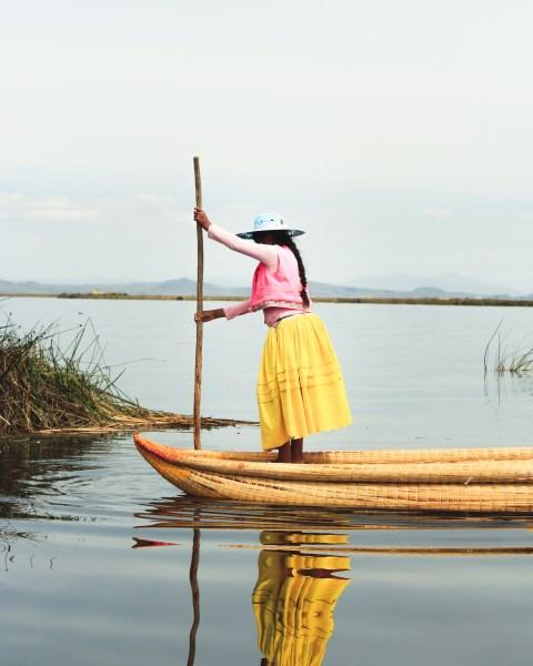 Woman in Boat in the Floating Islands, Lake Titicaca, Peru
