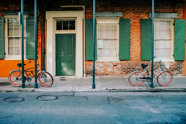 A building in New Orleans with two bikes