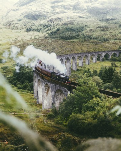 The Jacobite steam train crosses the Glenfinnan Viaduct