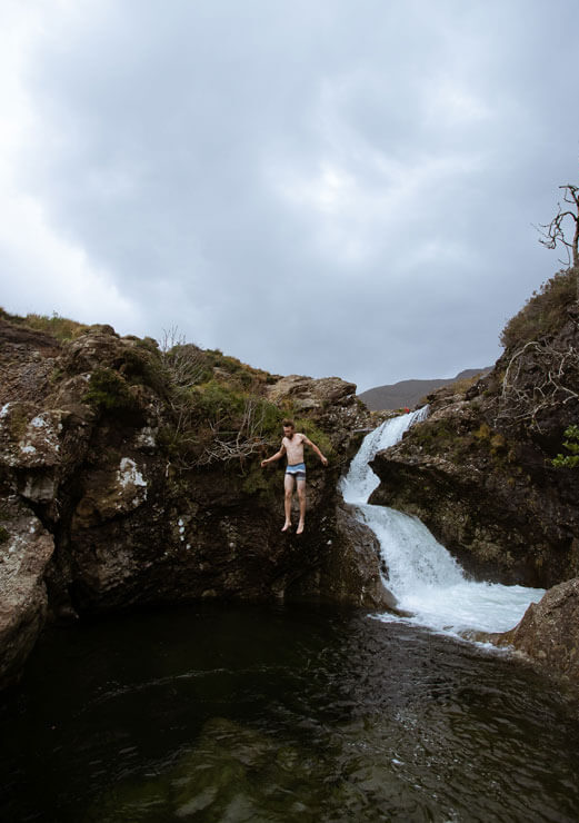 Man at the Fairy Pools on the Isle of Skye.