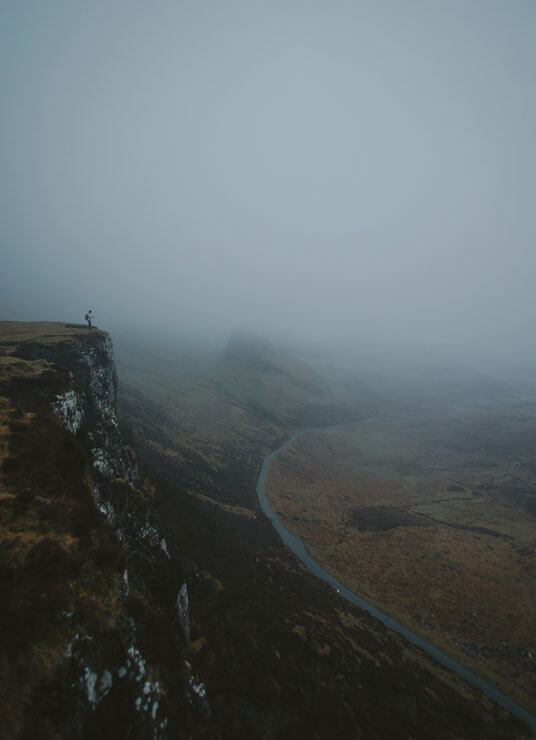 Person on the edge of the Quiraing on the Isle of Skye in Scotland.