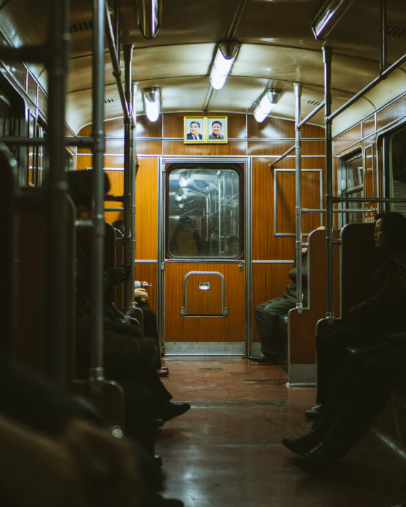 A dimly lit subway carriage in North Korea