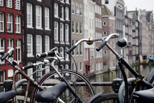 A line of parked bikes on a bridge in Amsterdam