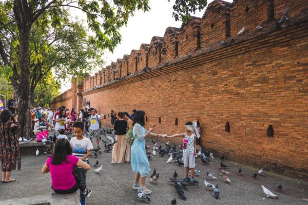 Children dance in front of Chiang Mai's Tha Phae Gate in a photo by creative Denis Amirtharaj.
