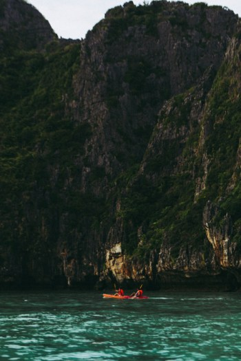 Two people kayaking in Maya Bay, Thailand.