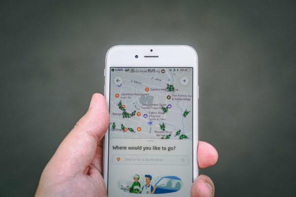 A navigation app asks where a traveler wants to go