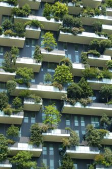 High rise building covered in living gardens