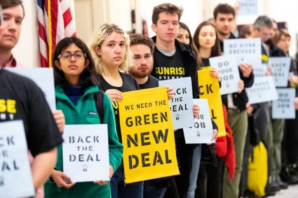 "Student members of the Sunrise Movement demonstrate in support of Alexandra Ocasio-Cortez's climate change legislation the ""green new deal."""