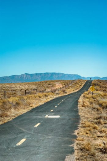 A long road in the New Mexico desert