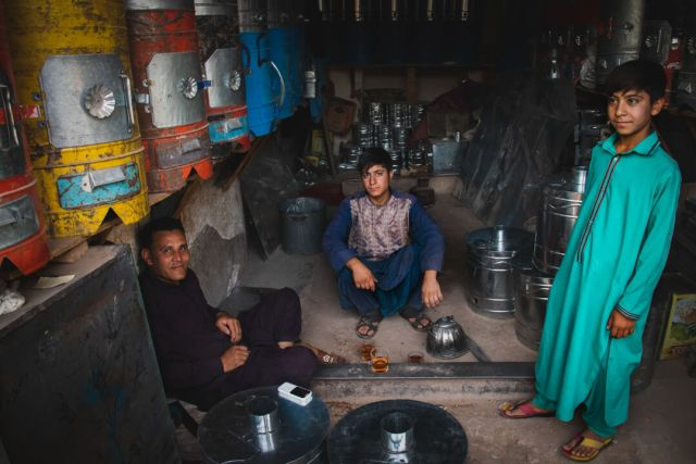 A family in central asia poses in their home.