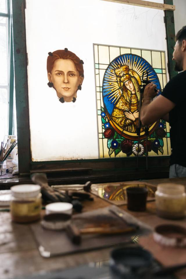 a stained glass artisan at work