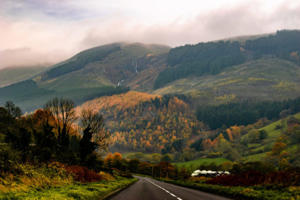 a road and mountains in mid-wales