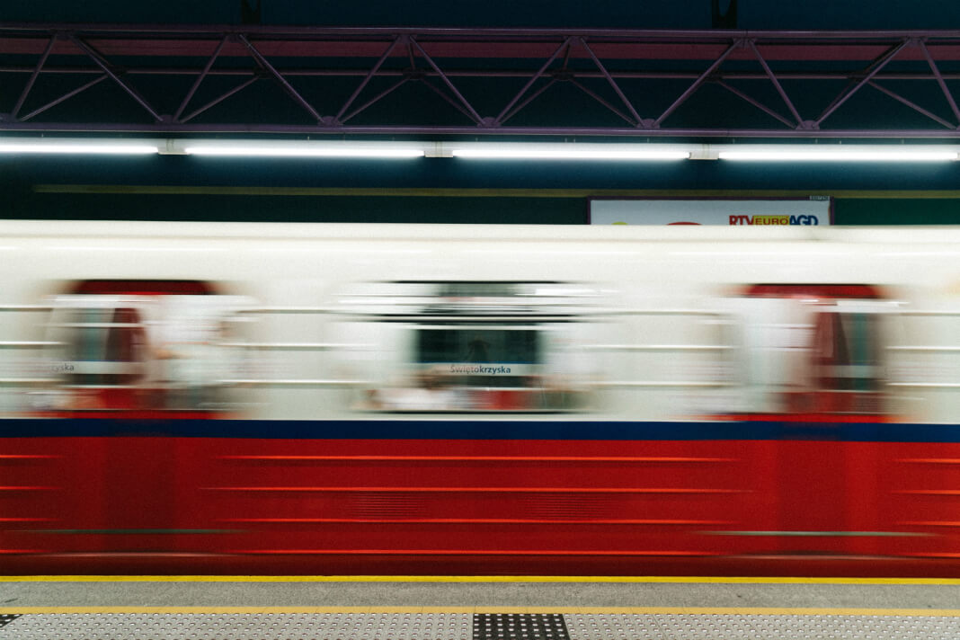 Blur of a metro train as it whizzes by the platform