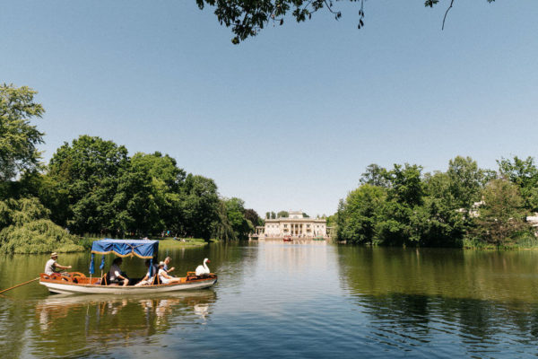 a boat on the water at warsaw's royal park in poland