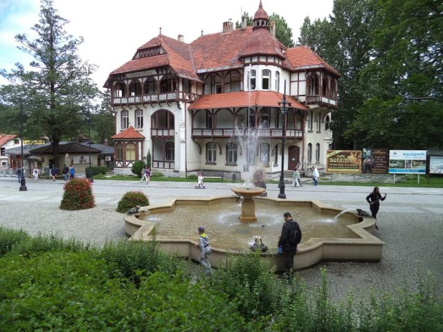 a fountain and guest house in a polish health town