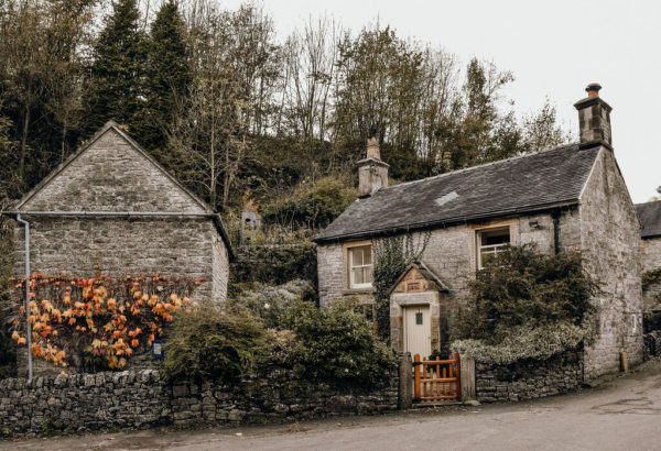 a cottage and gatehouse typical of british villages