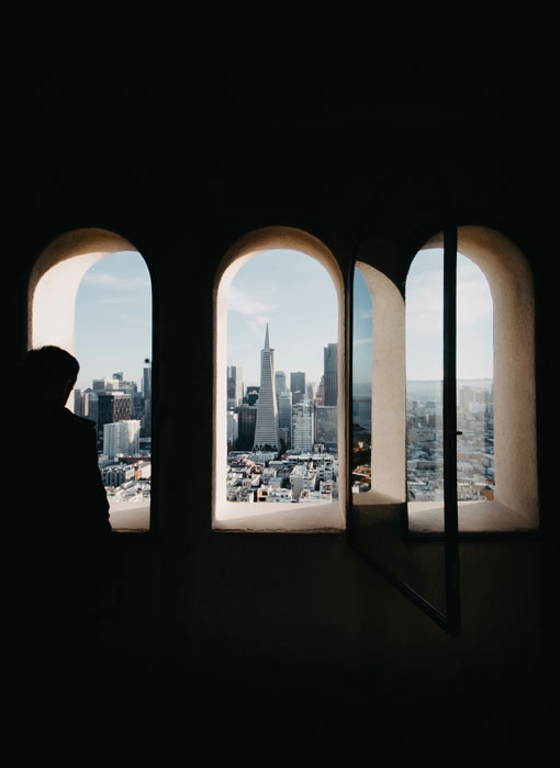 A view of San Francisco's skyline through three windows