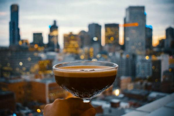 Espresso martini with city skyline behind