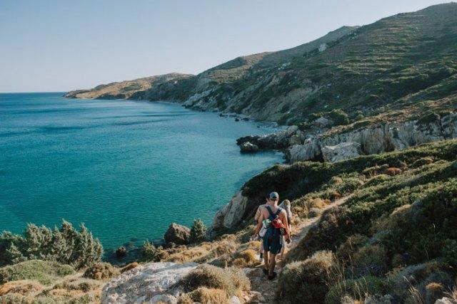 Three people hiking on a Greek island