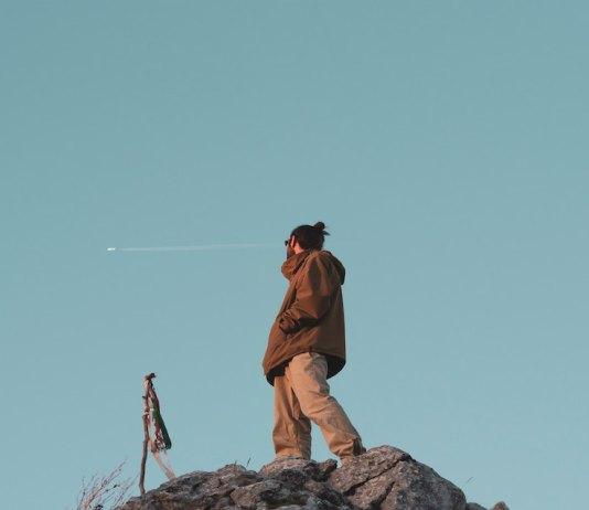man looking at sky