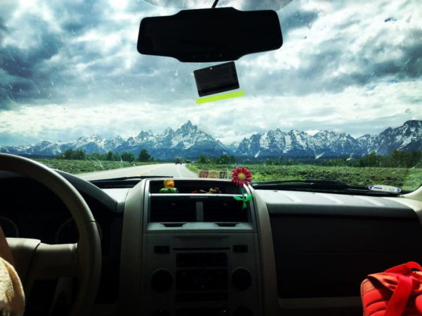 a view of the rocky mountains from a car interior