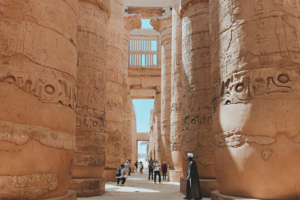 People walk in the shade at the Temple of Karnak