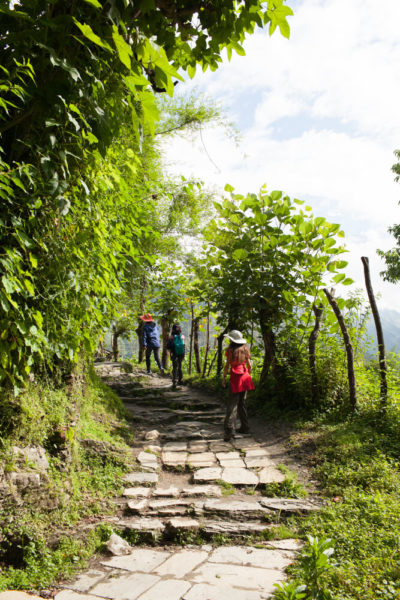 girls trekking on mountain path