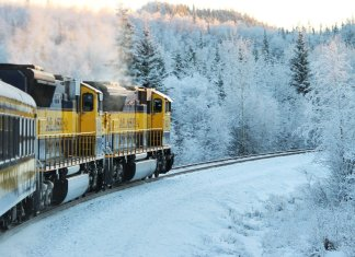 train turning a bend in snowy landscape