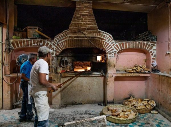 baker in mexican panaderia