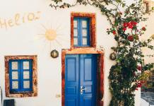 building with blue door and sun design