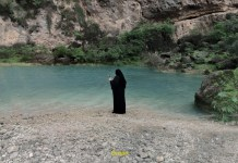 woman in black hijab at natural pool