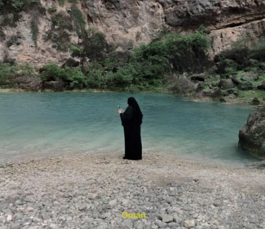 woman in black hijab at natural pool