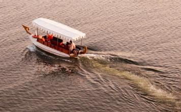 traditional indian boat crossing lake