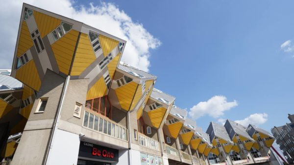 yellow cube houses atop residential buildings