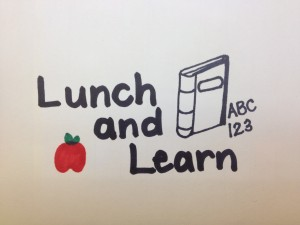 picture of lunch and learn with an apple and a book with ABC 123