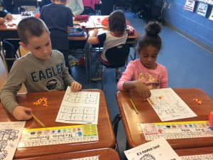 students adding and subtracting with candy corn