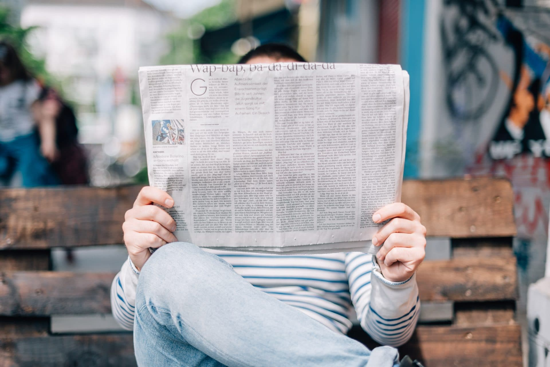 Picture of a man reading a newspaper for Real Estate News for Investors Podcast Episode #471