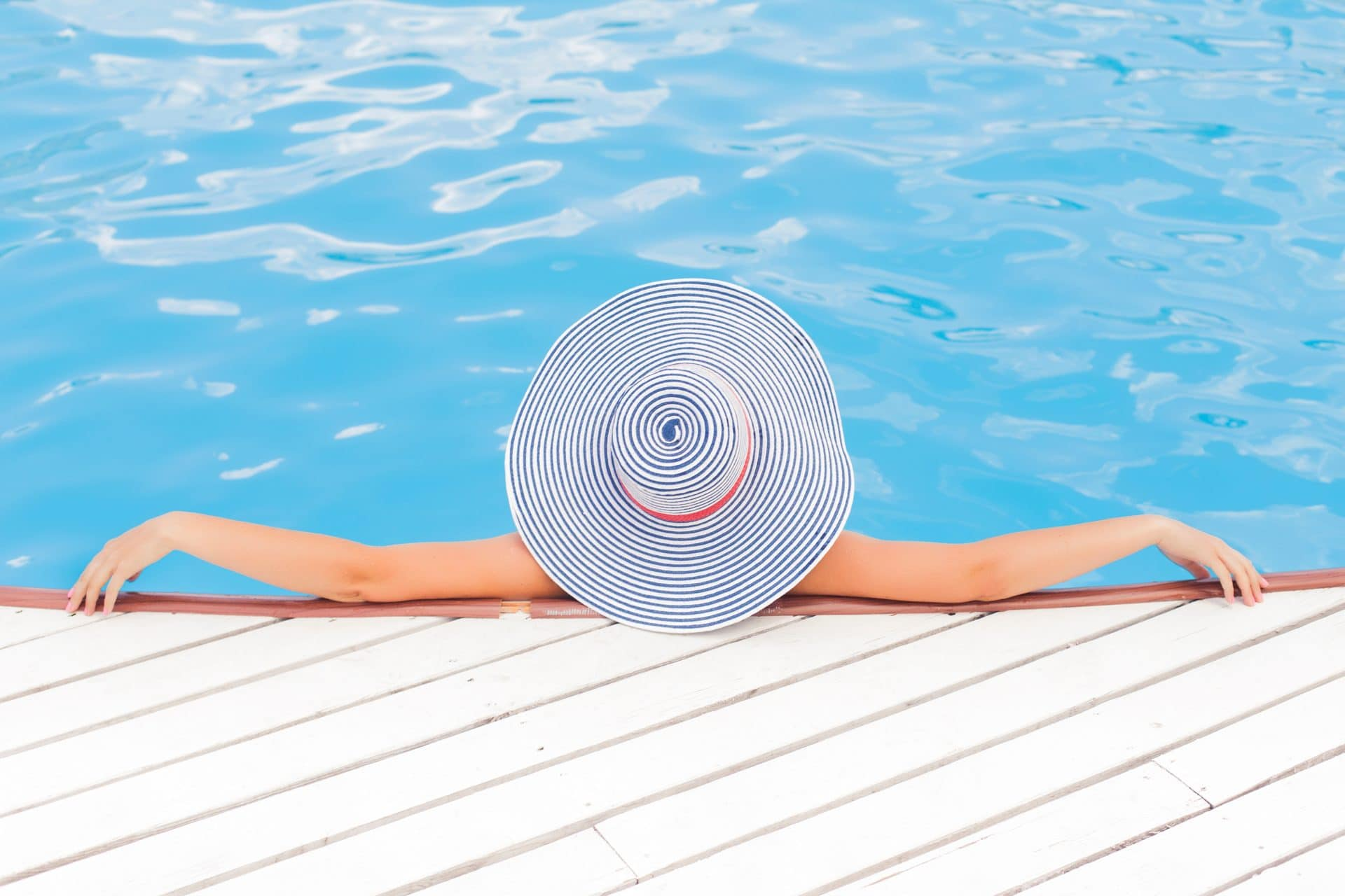 Picture of a lady in a swimming pool for Real Estate News for Investors Podcast Episode #472