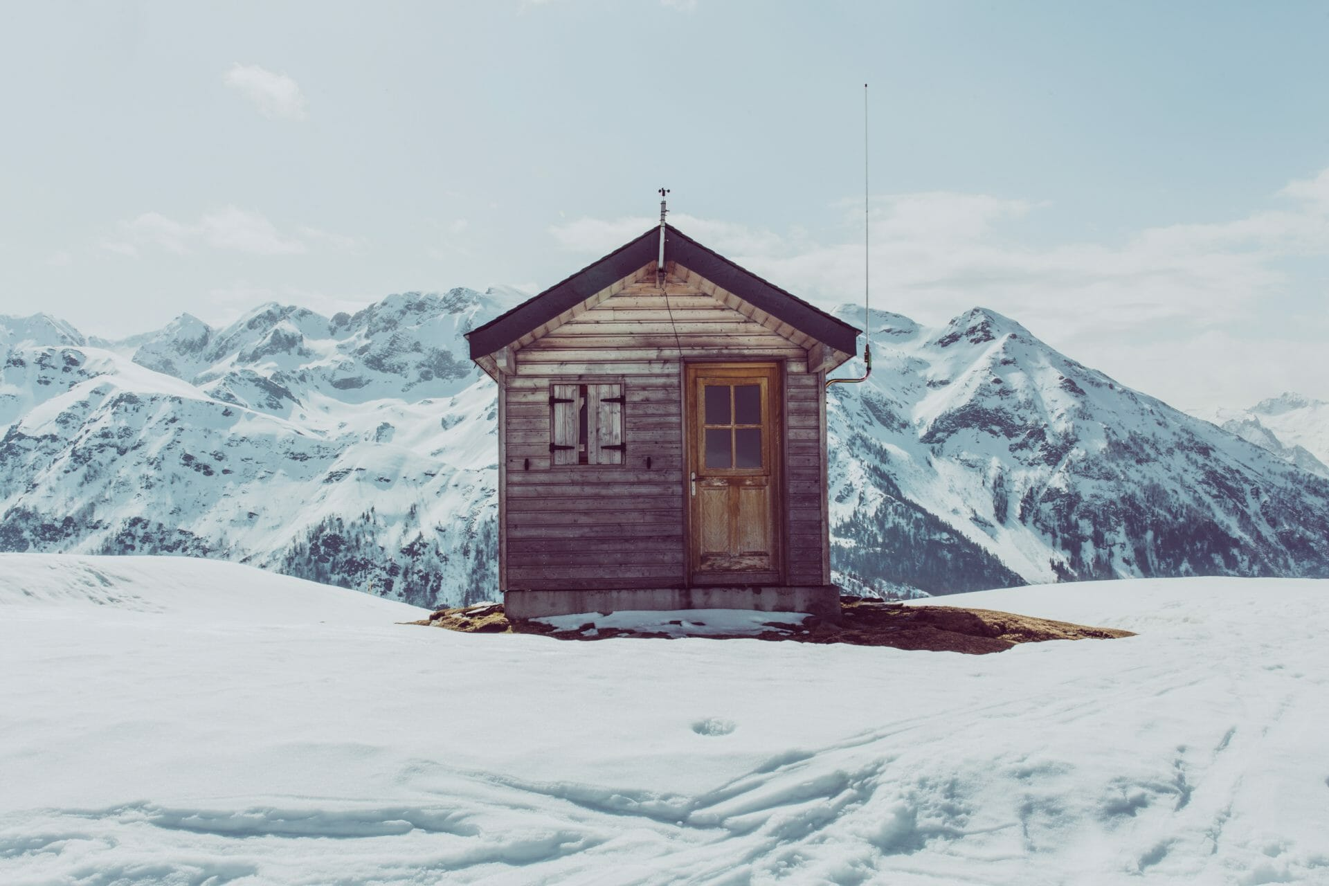 Picture of cabin in snow for Real Estate News for Investors Podcast Episode #742