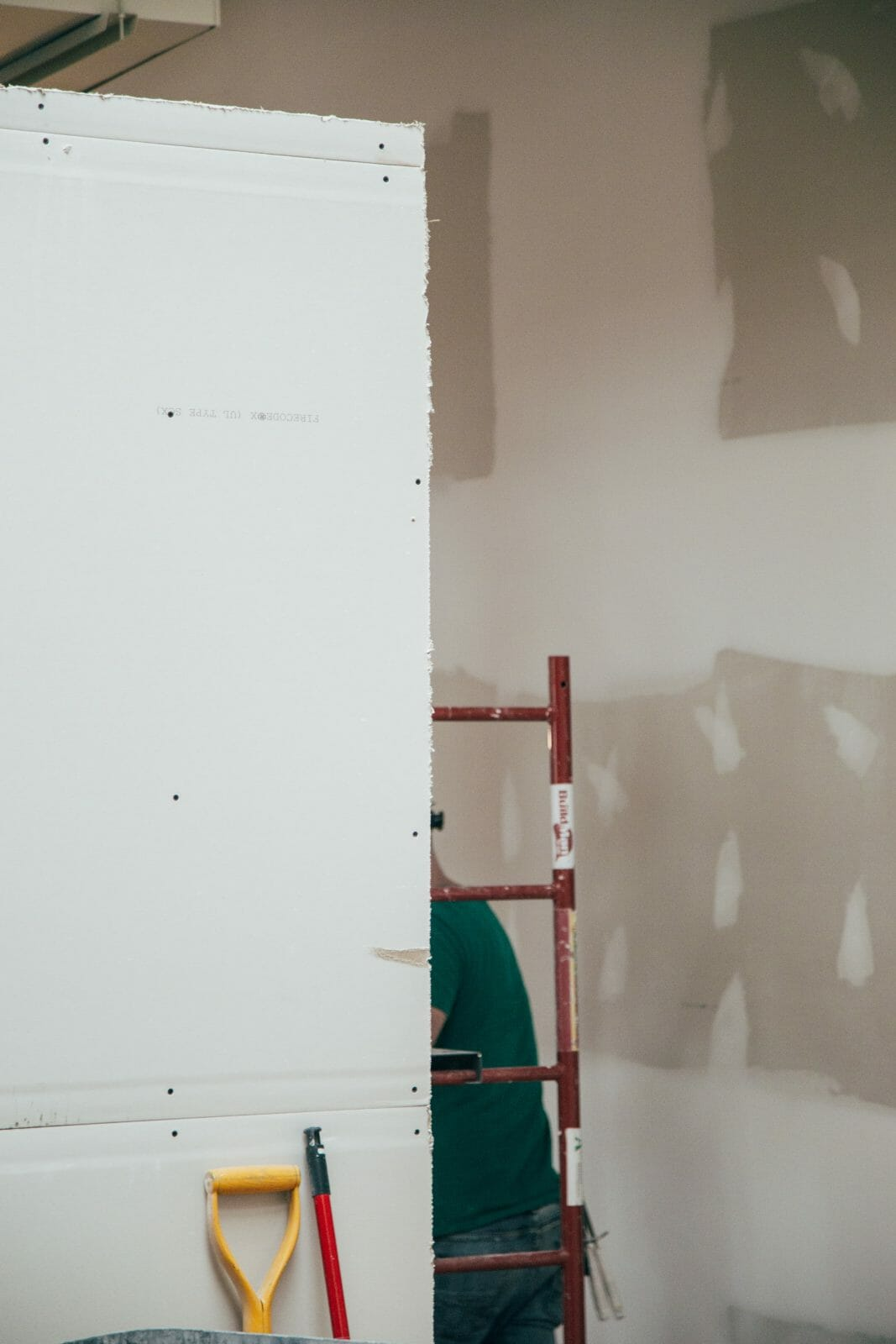 Picture of painter inside building for Real Estate News for Investors Podcast Episode #799