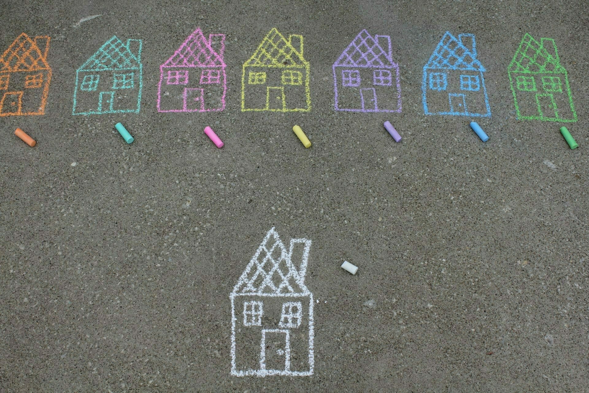 Picture of houses drawn on sidewalk for Real Wealth Show Episode #697