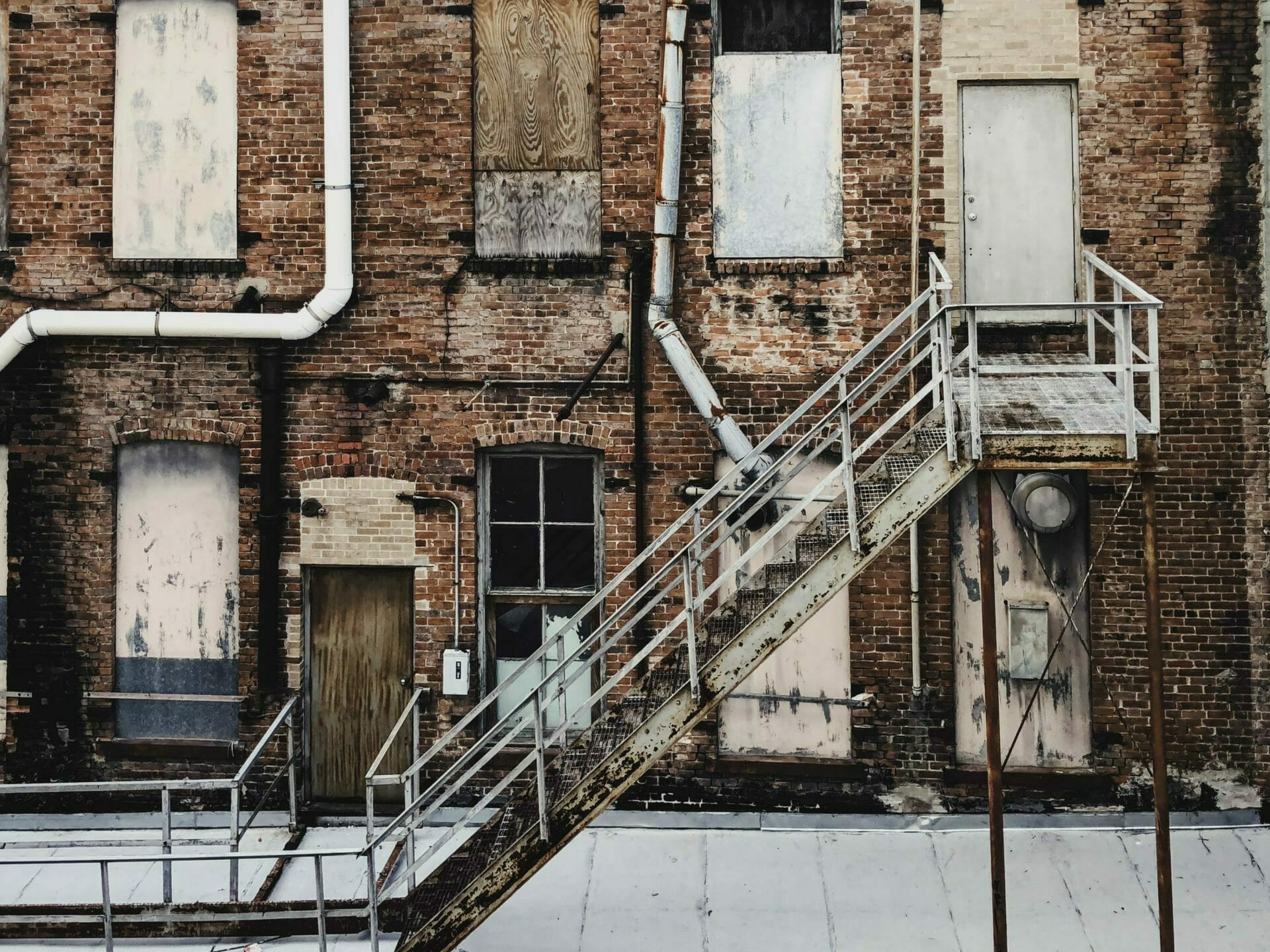 Picture of abandoned building with fire escape for Real Wealth Show Podcast Episode #711