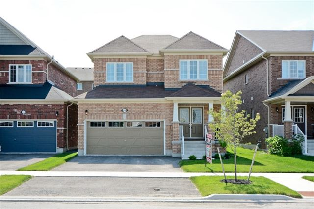 "Stunning 3 Bedroom All Brick Home, Only 1 Year Old In The Sought After And Family Friendly Windfields Community! This Falconcrest Homes ""Camellia"" Model, Is Loaded With Upgrades. 9 Ft Ceilings & Hardwood Thru-Out Main, Open Concept Great Room W/Gas Fire & Both Garage Entry & Separate Side Entry To Bsmt. Kitchen Has Chef's Faucet, Stainless Apps & Gas Range, 3 Spacious Beds Include Master With W/I Closet & 4 Pc Ensuite W/Seamless Glass Shower & Custom Vanity"