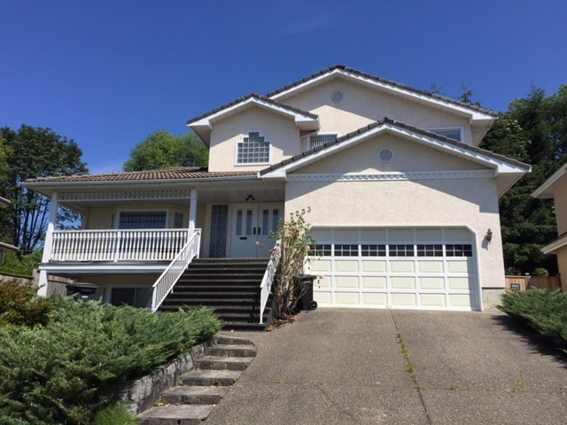 "Great desirable location in ""Montecito"" Burnaby, it's on the high side of street, North/South facing & the lot over 10,000 sq.ft. w/panoramic view at front.  Lots of potential on this 4100 sq.ft. home.  Very functional layout, bright & spacious, 4 bedrooms up, den + over 1000 sq.st.ft. fully finished basement.  Kitchen overlooking huge fenced backyard with 2 doors walk out to deck to enjoy summer BBQ's, its feature with sunken living rm, big dining rm, 3 fireplaces, skylights & lots more.  Very easy access to SFT, Skytrain, park, shopping.  It's a perfect location for you to live or a great holding/investment property."