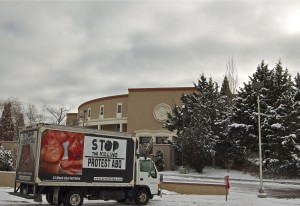 Representatives from the abortion opposition group Protest ABQ greeted Roundhouse visitors with signs and graphic imagery the morning of Jan. 22. (Photo credit: Margaret Wright)