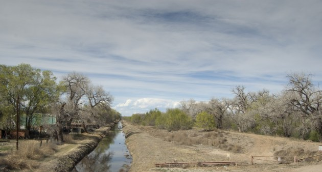 Early spring runoff courses through an acequia just north of the planned Santolina development.  Photo by Margaret Wright
