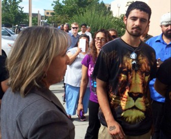 Michelle Lujan Grisham speaking to those in line in a Social Security office in Albuquerque. Courtesy photo.