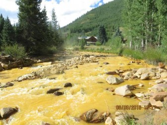 Photo of Gold King Mine spill results. Photo via Environmental Protection Agency.
